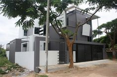 Mary's Residence - Actual side view of Front Elevation for Independent Bungalow by Ashwin Architects in Bangalore.    Call (+91)-(80)-26612520 for more information or visit http://www.ashwinarchitects.com