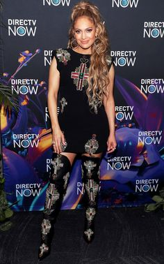 Jennifer Lopez in a Versace mini dress and over-the-knee boots