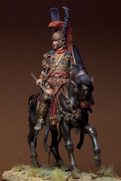Beautifully painted Roman Dekurion toy soldier on horseback.