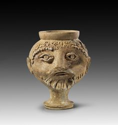 Roman beacker in form of the head of a bearded man. 2nd century A.D. Intact.