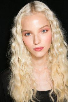 Sasha Luss crimped hair and soft makeup.