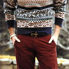 Shop this look for $62:  http://lookastic.com/men/looks/navy-crew-neck-sweater-and-burgundy-chinos-and-dark-brown-leather-belt/1531  — Navy Fair Isle Crew-neck Sweater  — Burgundy Chinos  — Dark Brown Leather Belt