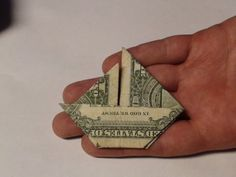 """Sailboat Money Origami - This was simple too. """"crazypcdude"""" seems to have additional money origami videos http://www.youtube.com/user/crazypcdude?feature=watch."""