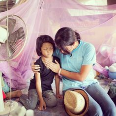 The photo for today is of a #LogosHope crew member as she prayed for a child in Thailand that lives in poverty.