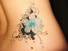Hibiscus Tattoo On Lowerback For Girls
