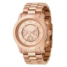 Birthday Wish! A rose goldtone chronograph dial highlights this stylish Michael Kors women's 'Runway' watch. This women's watch is crafted of stainless steel and secures with a deployment clasp.