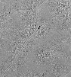 "Transmitted to Earth on Dec. 24, 2015, this image from the Long Range Reconnaissance Imager (LORRI) extends New Horizons' highest-resolution swath of Pluto to the very center of Sputnik Planum, the informally named plain that forms the left side of Pluto's ""heart."" Mission scientists believe the pattern of the cells stems from the slow thermal convection of the nitrogen-dominated ices that fill Sputnik Planum.  Image credit: NASA/JHUAPL/SwRI"