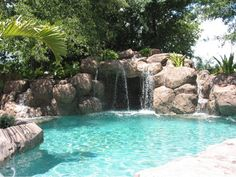 This is an awesome waterfall swimming pool!!!! However I would always be thinking there were snaking in the rocks..... Lol