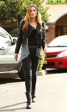 Punk meets comfort: Bella Thorne wowed yet again a statement leather jacket and boots duri...