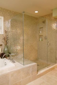 Tiled shower...tile runs the whole wall