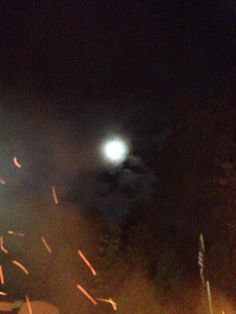 At a campfire and see the moon