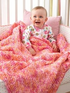 Knit from corner to corner, the Cuddly Seed Stitch Baby Blanket is a great exercise in stitch increases and decreases. Perfect for the novice knitter, this ultra-soft baby blanket looks adorable in both solid and variegated yarn types. Bernat Baby Blanket, Easy Baby Blanket, Blanket Yarn, Soft Baby Blankets, Knitted Baby Blankets, Baby Blanket Crochet, Afghan Crochet, Knitting For Kids, Baby Knitting Patterns