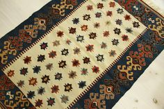 Kilim rug Turkish Kilim Rug New Vegetable dyes by kilimlife  Modern and well done, but for all its subtle color, somehow lacking the mellow beauty of antique kilims.  The color feels flat.