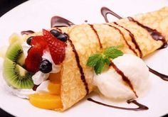 Mixed fruit Crepe with Nuttela and Vanilla Ice Cream