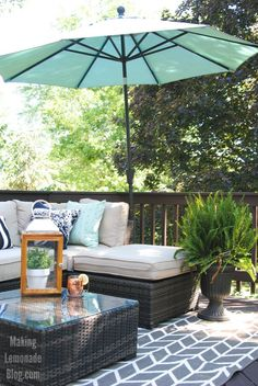 This DIY outdoor living room & deck makeover is budget friendly and resort inspired! What a great space for outdoor entertaining, dining, and outdoor movies too.