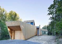 Faceted cedar cabin by Paul Bernier in Montreal woodland