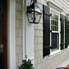 James Hardie Shingle Siding in Cobblestone with white trim and black shutters. Café Exterior, House Paint Exterior, Exterior Remodel, Exterior Paint Colors, Exterior House Colors, Paint Colors For Home, Exterior Design, Exterior Shutters, Window Shutters