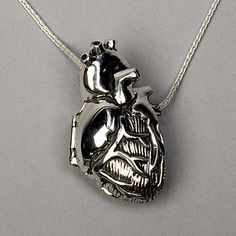 """Original Silver Anatomical Heart Locket The original Anatomical Heart Locket, by Peggy Skemp features a 1.5""""x .75""""x .5"""" (metric: 3.25cmx 1.7cmx .90cm) anatomically correct human heart which opens to reveal a meticulously detailed interior. It is pleasantly solid in cast and fabricated .925 silver, available in polished or antique finished silver. The locket is held shut by the trunk of the aorta which acts as a functional and secure snap…"""
