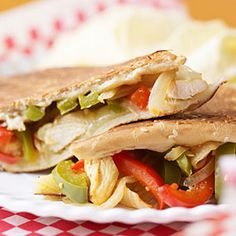 Chicken Philly Sandwiches Recipe Main Dishes with olive oil, boneless skinless chicken breasts, salt, ground black pepper, red bell pepper, green bell pepper, onion, white wine vinegar, salt, garlic cloves, hot pepper sauce, submarine rolls, provolone cheese