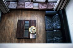 Windowseat, slouchy leather couch, worn wood floor. Mary Gaudin Photography.