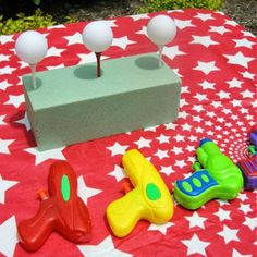 Carnival / Circus Themed Birthday Party The goal is to knock down the ping pong balls off of the tees with the squirt gun.The goal is to knock down the ping pong balls off of the tees with the squirt gun. Carnival Themed Party, Carnival Birthday Parties, Carnival Themes, Party Themes, Party Ideas, Carnival Theme Activities, Game Ideas, Halloween Carnival Games, Carnival Party Decorations