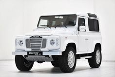All white Land Rover Defender 90