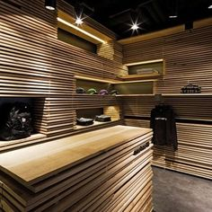 wood in retail design.  Studio lighting ? Maybe some difference covered panels or a paint on the edges?