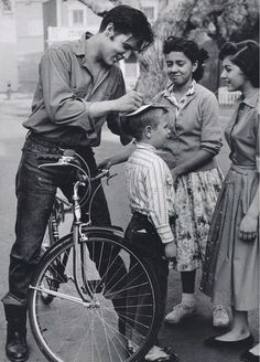 Early photo of Elvis signing autographs.
