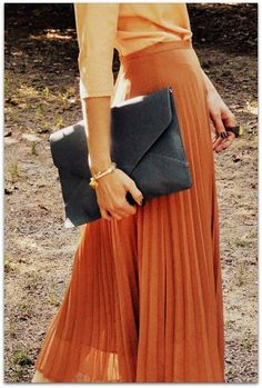 Suddenly matchy-matchy is super cool again... Here is a subtler approach with the shades of orange and lovely navy envelope clutch.