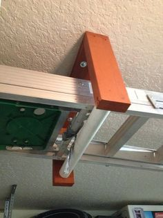 Ceiling mounted ladder rack