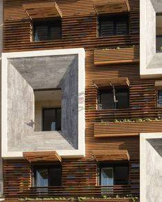 Faceted window frames project from the slatted timber and stained-glass facade of this apartment block in Tehran, designed by Iranian studio Keivani Architects. Facade Architecture, Residential Architecture, Contemporary Architecture, Contemporary Houses, Commercial Architecture, Building Facade, Building Exterior, Facade Design, House Design