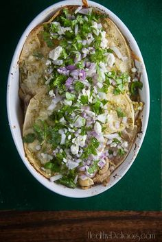 stacked chicken enchiladas verdes