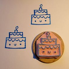 Happy Cake hand carved rubber stamp ready to be shipped by hola