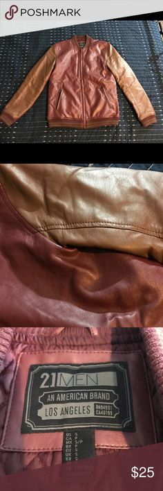 Men's jackets Forever 21 Men's faux leather jacket, maroon and brown. Good condition! Only flaw is right side pocket is broken at very bottom of zipper as pictured, zipper still works as long as not zipped all the way down to that bottom notch! Two pockets on the outside and one inside pocket 21men Jackets & Coats