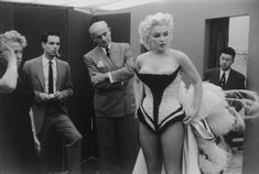 Marilyn Monroe by Ed Feingersh-1955-Try dress for a charity event at Madison Square Garden