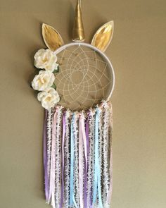 Whimsical Unicorn Dreamcatcher Made with yarns, trims, beads, ribbons, wood, and florals. Medium size Dreamcatcher Perfect for: Nurseries, birthdays, parties, home decor, photo props, or gifts Handmade in NJ