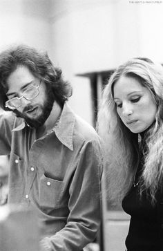 "Barbra Streisand and music producer Rupert Holmes photographed during a recording session of ""LAZY AFTERNOON"" in 1975."