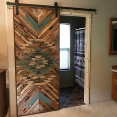 Rustic Tribal Aztec Sliding Barn Door DESCRIPTION Sliding barn doors are the perfect way to separate a room while also serving as a gorgeous piece of art. This is a completely one of a kind barn door with a unique design. You will find no other like it. Handmade Home Decor, Diy Home Decor, Room Decor, Decoration Ikea, Barn Door Designs, Interior Barn Doors, Barn Door Hardware, Rustic Design, Wood Design