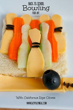 Back-to-School Food Art - A fun food art project inspired by my favorite back-to-school pastime--Bowling! Easy to make, fun to eat! #CalOliveCrafts #CleverGirls