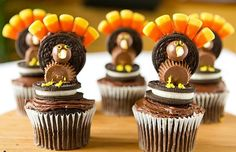 Turkey Cupcakes   via Brown Eyed Baker  Cupcakes, tops flattened and lightly frosted (see Dark Chocolate Cupcakes and Chocolate Buttercream) Oreo cookies Whoppers Miniature Reese's peanut butter cups Candy corn Assorted icing – yellow, white and red.