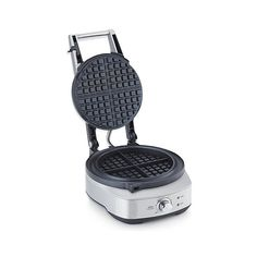 Great-tasting waffles without a mess. This round waffle iron has a wide wrap-around moat that catches batter overflow and then cooks it for easy removal. Thick plates distribute heat for even browning, which you can customize with seven browning settings. Small Kitchen Appliances, Kitchen Gadgets, Kitchen Stuff, Waffle Maker Reviews, Steel House, Waffle Iron, Browning, Crate And Barrel, Crates
