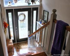Split Level Entryway and Door. All glass panes on door to add more light to what can be a dark space in a split level. - redo our bannister! Get rid of the metal, and add wood! Split Foyer Entry, Split Level Entryway, Front Entry, Entry Foyer, Entry Level, Foyer Design, House Design, Split Entry Remodel, Bi Level Homes