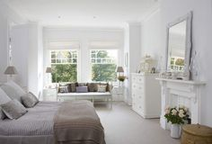 romantic pure white bedroom with painted furniture, Rococo mirror and antique fireplace - The Paper Mulberry: Perfectly Pale