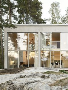Positioned on the Swedish coastline, this concrete house by Arrhov Frick features a glazed facade which allows glimpses of the Baltic sea through the trees. Exterior Design, Interior And Exterior, Architecture Design, Contemporary Architecture, Biophilic Architecture, Dezeen Architecture, Contemporary Houses, Futuristic Architecture, Sweden House