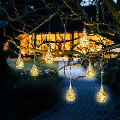 Each tiny teardrop terrarium decking this tree contains a cluster of battery-powered LED copper wire lights. Our easy DIY explains how to recreate the look in your own yard.