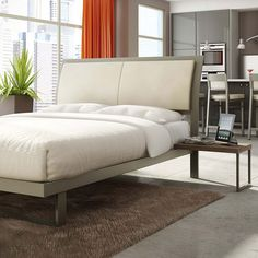 The Solitude Platform Bed is constructed from fully welded, cold-rolled steel with a durable powdercoat finish and an eggshell bonded leather headboard. It is available in a variety of finishes and fabrics.