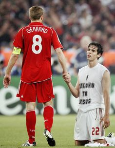"It is done – AC Milan have just beaten Liverpool FC in the 2007 UEFA Champions League and are European Champions. Reds captain Steven Gerrard shakes the hand of Rossonero Ricky Kaká, in full ""I belong to Jesus"" attire for the occasion. Football Is Life, World Football, Sport Football, Steven Gerrard, Fc Liverpool, Liverpool Football Club, Ricardo Kaka, Premier League, Stevie G"