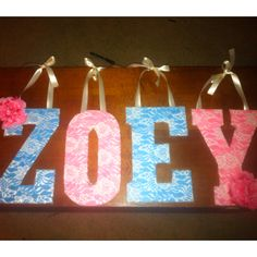 Wooden letters wrapped with lace