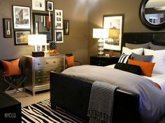 classic, masculine. love the pops of orange. Great Color for teenage boy bedroom.