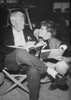 Katharine Hepburn looks adoringly up to Spencer Tracy while on a set.